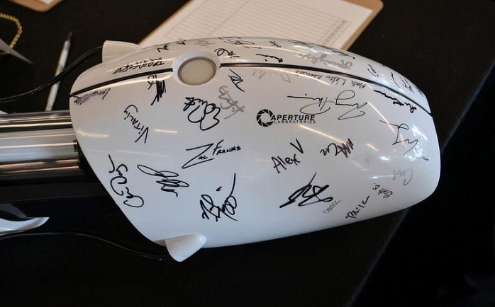 A full-size Portal gun, signed by the fine people at Valve
